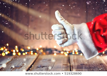 Santa Claus thumbs up Stock photo © HASLOO