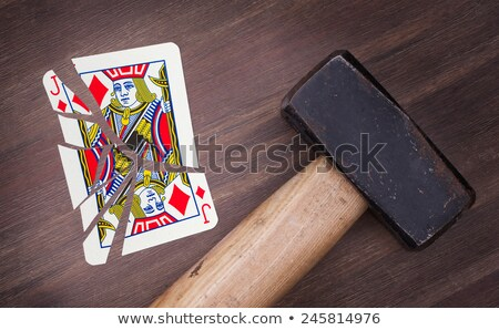 Hammer with a broken card, jack of clubs Stock photo © michaklootwijk