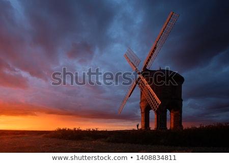 Moulin à vent coucher du soleil Photo stock © chrisga