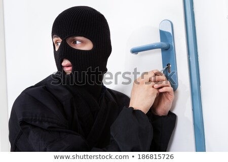 Thief Opening Door With Tool During House Breaking Stock photo © AndreyPopov