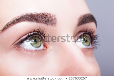 Young beautiful woman with day makeup and  green pistachio colou Stock photo © zastavkin