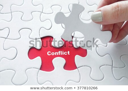 WAR - Puzzle on the Place of Missing Pieces. Stock photo © tashatuvango