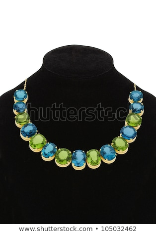 pendant with green and blue gem stones on black mannequin isolat stock photo © tetkoren