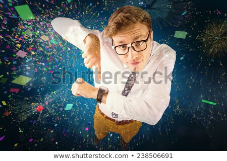 Geeky businessman pointing to watch Stock photo © wavebreak_media
