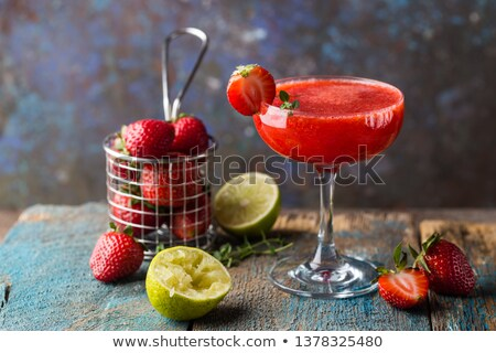 Cocktail with strawberry syrup isolated stock photo © jordanrusev