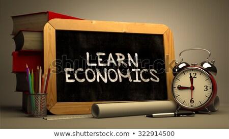 Tanul közgazdaságtan kézzel írott fehér kréta iskolatábla Stock fotó © tashatuvango