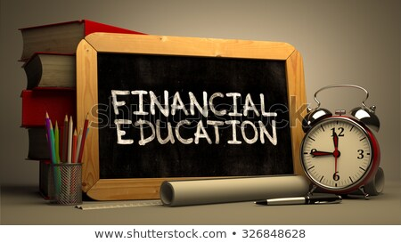 financial education handwritten by white chalk on a blackboard stock photo © tashatuvango