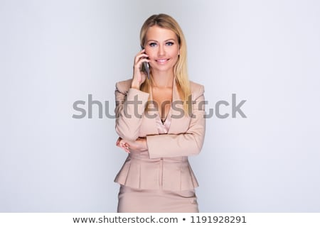 Candid image of a young woman talking on the phone and makes not Stock photo © vlad_star