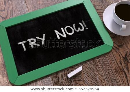 Try Now - Inspirational Quote on Chalkboard. Stock photo © tashatuvango