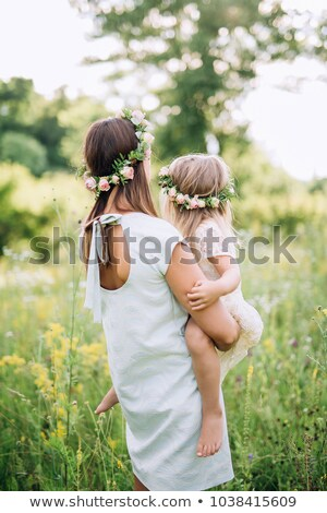 Stock photo: Beautiful woman in white dress and roses wreath standing barefoot
