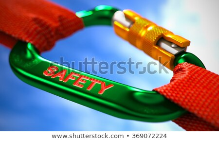 Safety on Green Carabiner between Red Ropes. Stock photo © tashatuvango