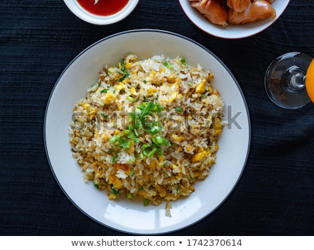 Fried rice with sausage and vegetables on white background Stock photo © art9858