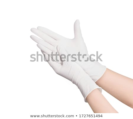 Putting on latex gloves Stock photo © pakete