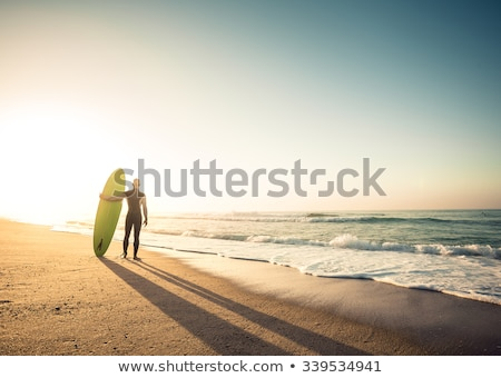 handsome man with surfboard stock photo © anna_om