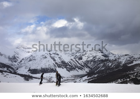 High snowy mountains and gray storm sky before blizzard Stock photo © BSANI