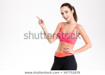 довольно Фитнес-женщины Постоянный позируют изолированный фото Сток-фото © deandrobot