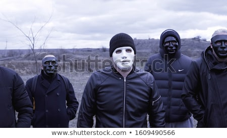 Criminal gang of men Stock photo © jossdiim