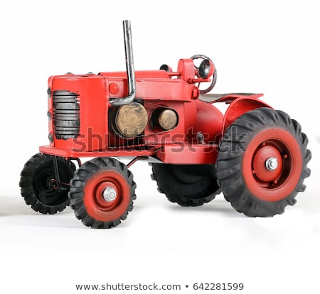 Farmer playing with small agricultural tractor toy Stock photo © stevanovicigor