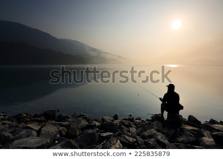 fishing on a mountain lake sunset in the mountains night fishing stock photo © leo_edition