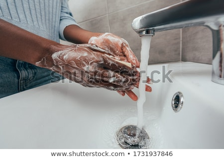 Cropped image of person washing hands at sink Stock photo © wavebreak_media