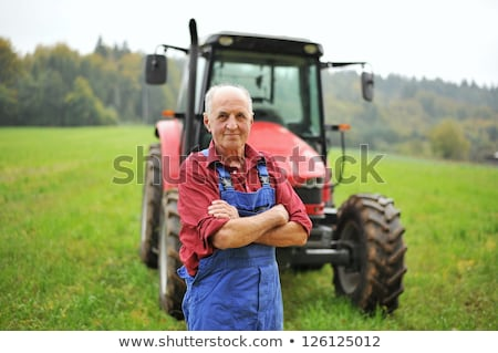 Driver Standing In Front Of Tractor Stock photo © monkey_business
