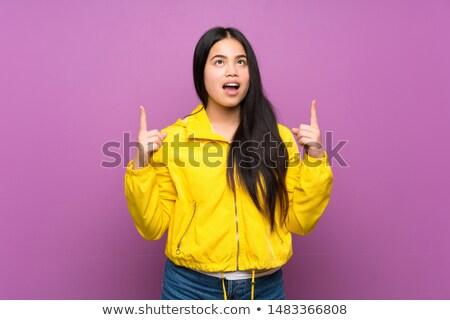 アジア 代 女性 ポイント 見上げる ストックフォト © palangsi