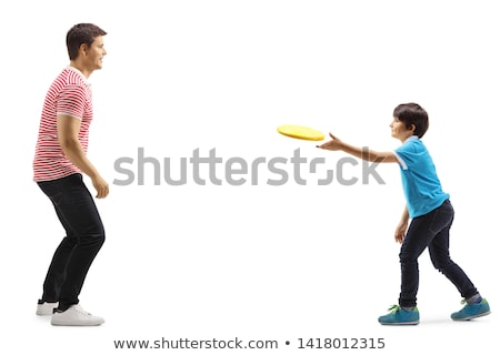 boy and father play frisbee stock photo © is2