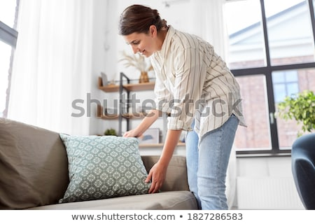 Woman on sofa with cushion Stock photo © IS2