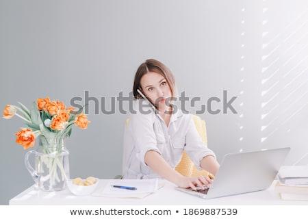 Tired exhausted female freelancer talking on mobile phone Stock photo © stevanovicigor