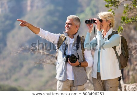 Adam işaret dışarı kadın dürbün orman Stok fotoğraf © wavebreak_media