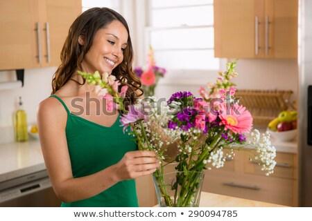 femme · fleur · maison · fleurs · heureux · salon - photo stock © is2
