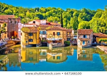 village of borghetto on mincio river view stock photo © xbrchx