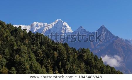 Berg Nepal regio hemel boom bos Stockfoto © dutourdumonde
