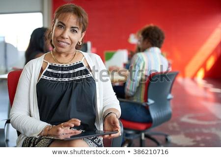 Közel-keleti üzletasszony ül szék üzlet iroda Stock fotó © monkey_business