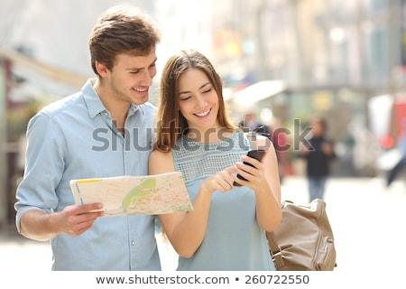 женщину глядя карта смеясь стены весело Сток-фото © IS2