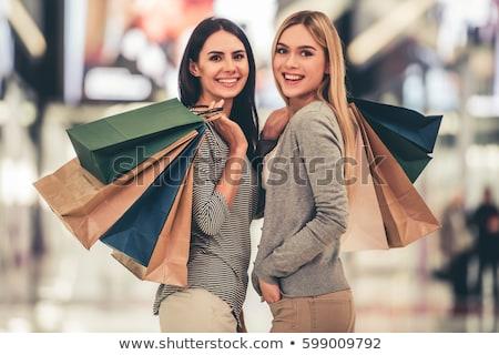 Fiatal nő modern vásárlás központ nő mosoly Stock fotó © lightpoet