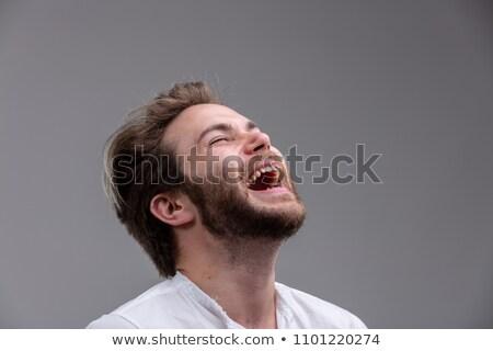 Fiatalember értelem humor élvezi nevetés jókedv Stock fotó © Giulio_Fornasar