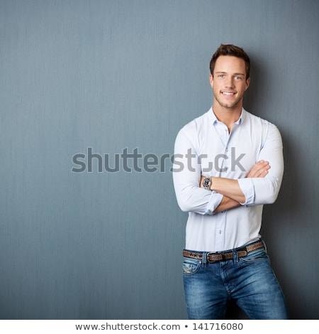 молодые бизнесмен синий улыбаясь молодым человеком длинный рукав Сток-фото © lubavnel