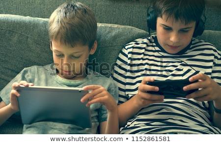 Retrato feliz nino jugando videojuegos Foto stock © deandrobot