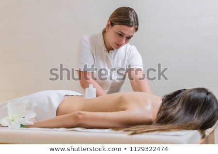 therapist giving massage to female stock photo © andreypopov
