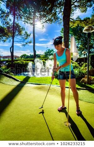 Stock fotó: Mini · golf · nő · játszik · zöld · fű · naplemente