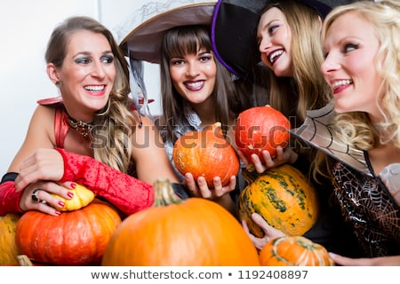 four beautiful women acting as witches joining their malicious forces stock photo © kzenon