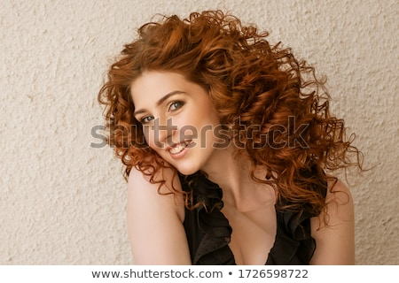 Pretty woman with curly black hair Stock photo © acidgrey