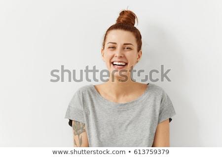 mosolygó · nő · pózol · téglafal · portré · nő · boldog - stock fotó © acidgrey