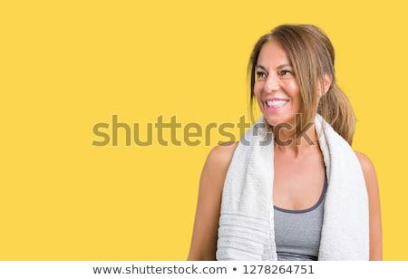Oldalnézet mosolyog sportok nő megnyugtató másfelé néz Stock fotó © deandrobot
