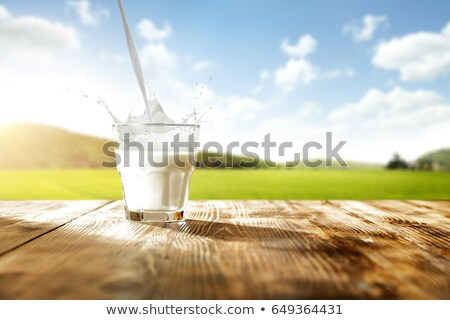 Glass Of Milk On Wooden Desk Stock photo © AndreyPopov
