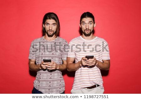 Portret twee jonge opgewonden tweeling broers Stockfoto © deandrobot