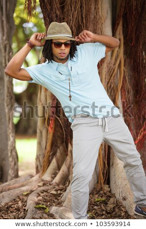 Attractive man adjusting his necklace Stock photo © feedough