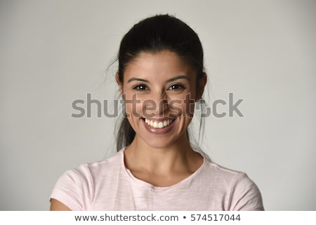 Charming young woman with nice smile Isolated on gray background Stock photo © studiolucky