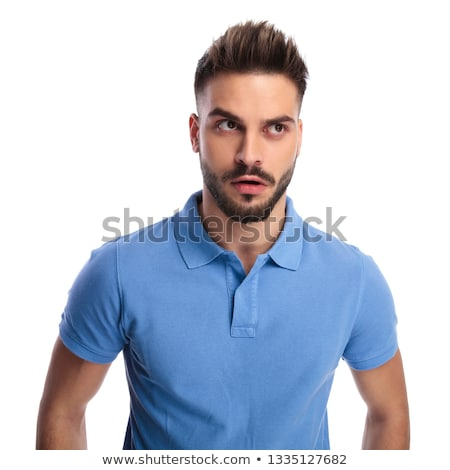 young man wearing a light blue polo trying to remember something stock photo © feedough
